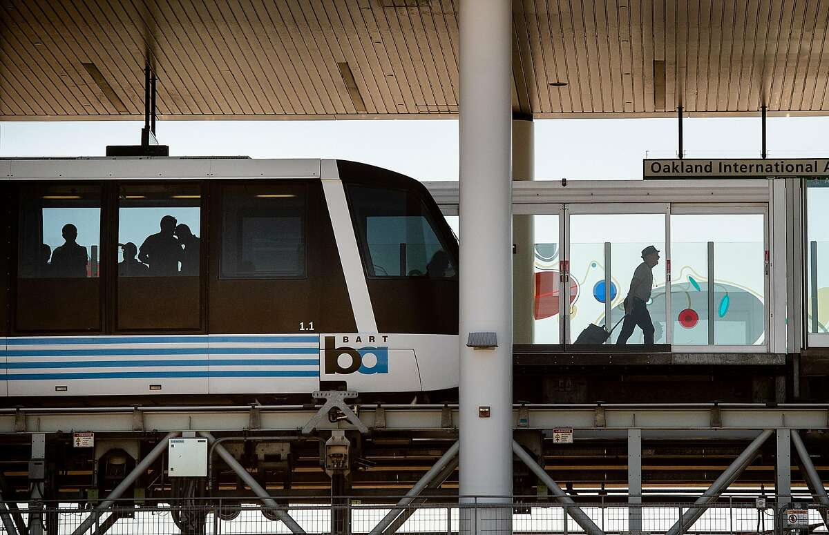 A traveller passes behind security doors after disembarking from an Oakland Airport BART connector train on Tuesday, Sept. 24, 2019, in Oakland, Calif.