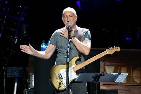 """Pete Townshend  of British rock band """"The Who"""" performs at the Toyota Center on the second leg of their Moving On! tour on September 25, 2019 in Houston, Texas. (Photo by SUZANNE CORDEIRO / AFP)        (Photo credit should read SUZANNE CORDEIRO/AFP/Getty Images)"""