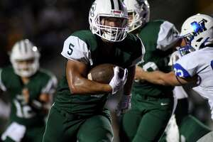 Kingwood Park senior running back Desmond Benjamin has his eyes on the end zone as he rushes for a touchdown in the third quarter against Barbers Hill in their non-district matchup at Turner Stadium in Humble on Sept. 14, 2019.
