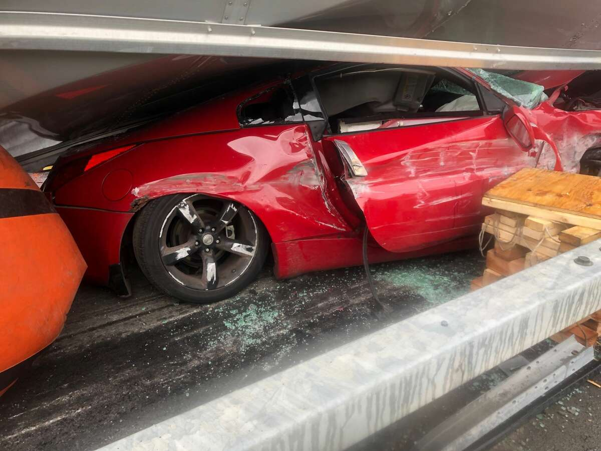 This close-up photograph shows the small pocket of space on the passenger's side of a crash where a driver was protected from devastating injuries when his car was crushed by a tractor trailer on Interstate 787.