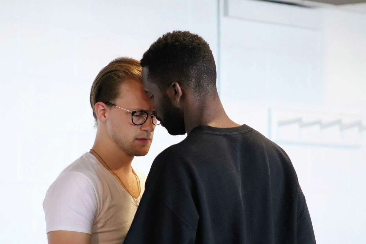 """Jeremiah Clapp, left, as Thomas, and Calvin Leon Smith, as Russell, rehearse for """"On the Grounds of Belonging,"""" onstage at Long Wharf Theatre, Wednesday, Oct. 9, through Sunday, Nov. 3."""
