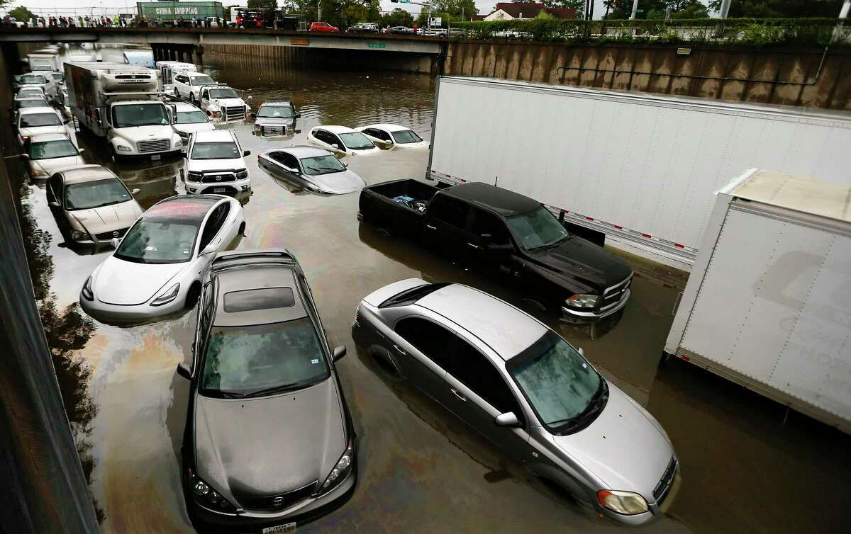 Abandoned cars and trucks in southbound Interstate 45 near Main Street are flooded in water after the remnants of Tropical Storm Imelda made their way through Houston on Sept. 19, 2019.