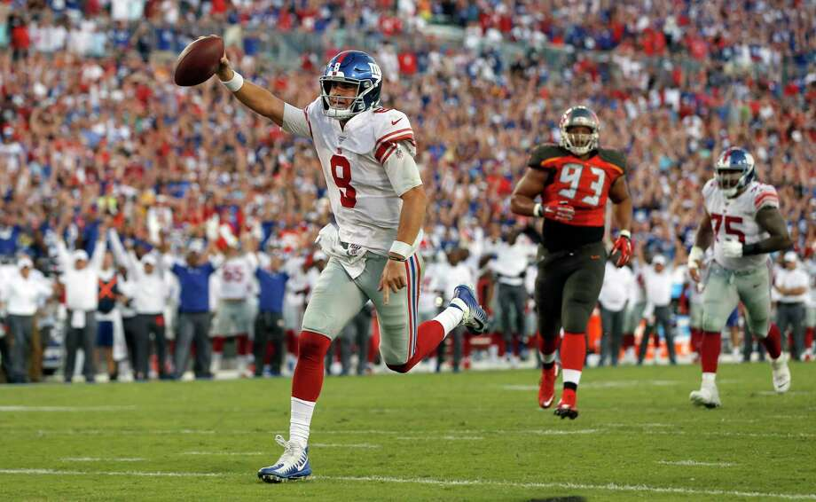 New York Giants quarterback Daniel Jones (8) scores on a 7-yard touchdown run against the Tampa Bay Buccaneers during the second half of an NFL football game Sunday, Sept. 22, 2019, in Tampa, Fla. Photo: Mark LoMoglio / Associated Press / Copyright 2019 The Associated Press. All rights reserved.