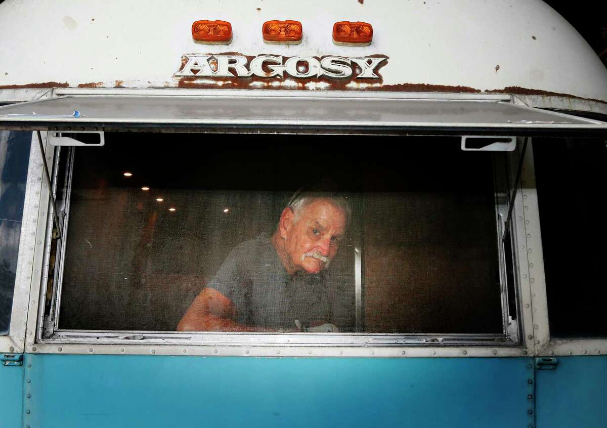 Larry Williams inside his latest trailer project for Go Vintage Trailers, his San Antonio-based business that renovates and rents out vintage travel trailers.