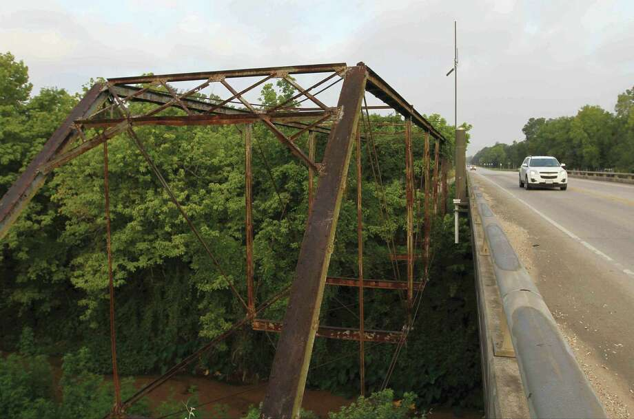 The cities of Conroe and Montgomery are both looking into relocating the historic truss bridge on FM 2854 to a new location for restoration and display. Photo: Staff Photo By Jason Fochtman, Photographer / AP