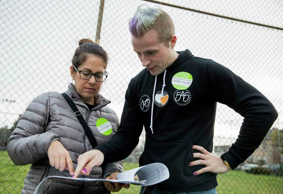 Volunteers plan out a route while conducting the biennial Point in Time homeless count in this archive shot. Photo: Jessica Christian / The Chronicle / ONLINE_YES