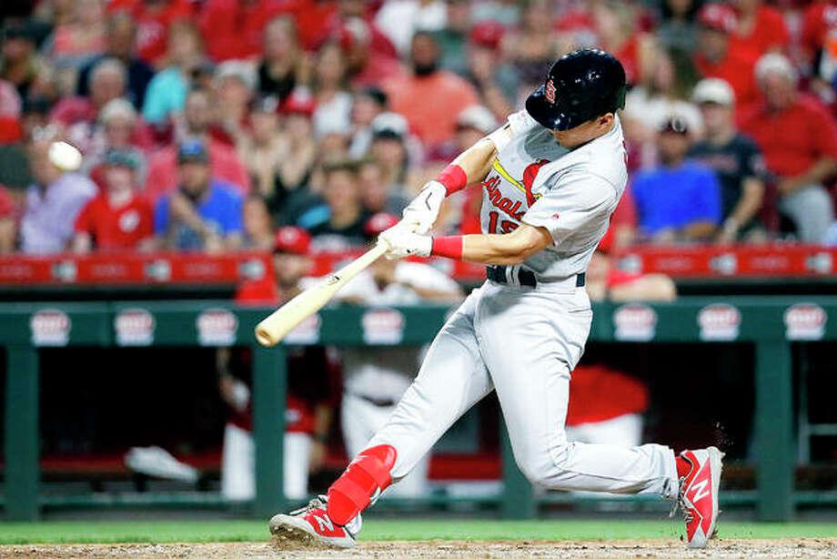The Cardinals' Tommy Edman hits a grand slam off Cincinnati Reds relief pitcher Robert Stephenson in a July 18 game in Cincinnati. Photo: AP Photo