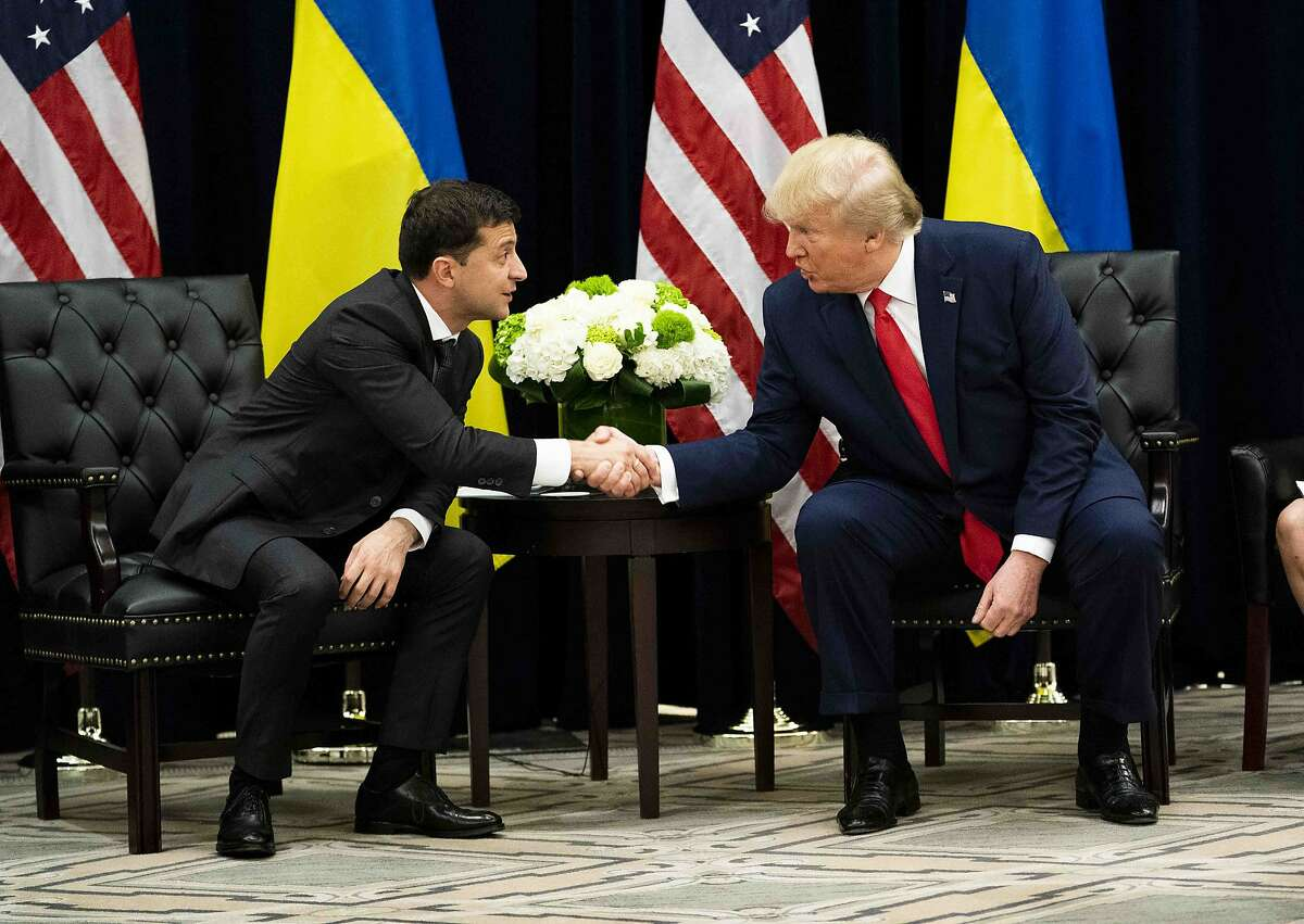"""FILE-- President Donald Trump meets with President Volodymyr Zelenskiy of Ukraine, at the InterContinental New York Barclay, on Wednesday, Sept. 25, 2019, in New York. Trump used the power of his office to try to get Ukraine to interfere in the 2020 election to investigate a political rival """"for personal gain,"""" according to an explosive whistle-blower complaint released on Thursday after days of damning revelations about Trump's dealings with Ukraine. (Doug Mills/The New York Times)"""