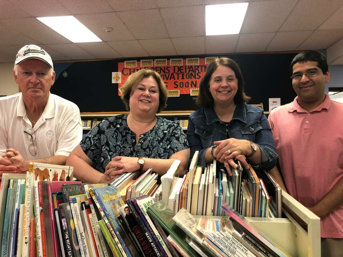 Pictured, left to right, are Library Board Chair Jim Geissler, Shelton Library Director Joan Stokes, library Children's Programmer Maura Gualtiere and Teen Library Assistant Joseph Cappella in the soon-to-be-renovated Children's Department at Plumb Memorial Library.