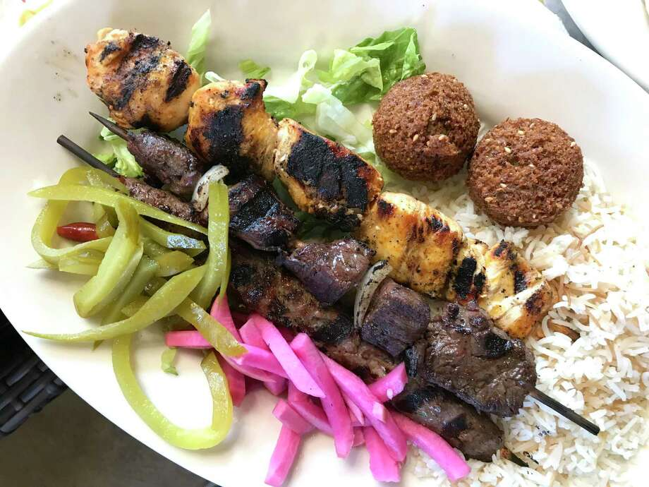 Chicken, beef and lamb kabobs with pickled vegetables, rice and falafel from Al-Amir Cafe & Grill Photo: Paul Stephen / Staff