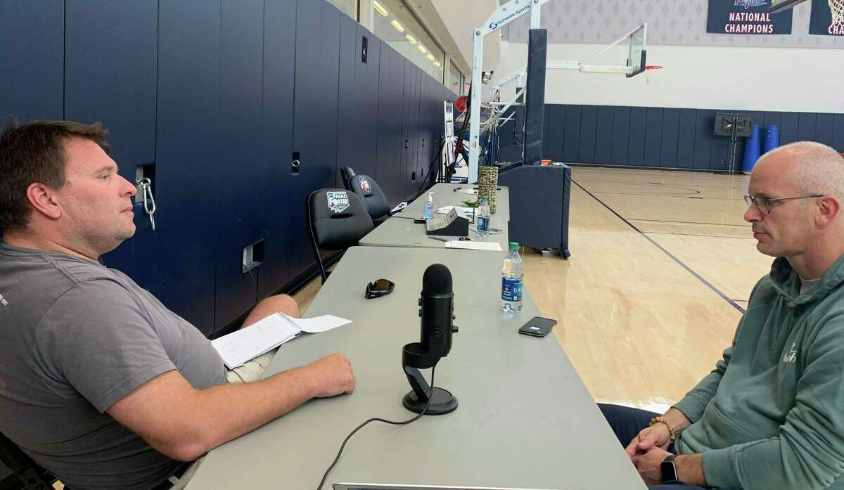 David Borges talks with UConn men's basketball coach Dan Hurley during the recording of a podcast.