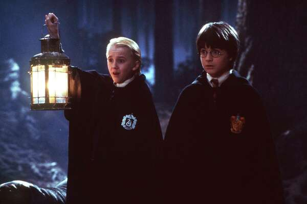 HARRY5-C-29OCT01-DD-HO Draco Malfoy (Tom Felton) and Harry Potter (Daniel Radcliffe) in the Dark Forest in HARRY POTTER AND THE SORCERER'S STONE.