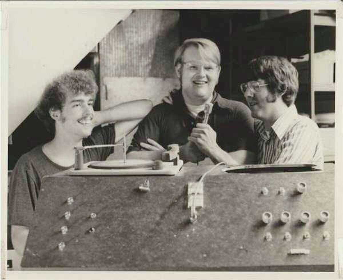 William Dickerson, brothers Scott and John Seeburger in 1979, long after their radio station went off the air.(Photo provided/Scott Seeburger)