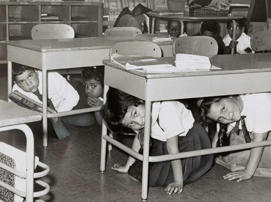 Students at a Brooklyn middle school have a 'duck and cover' practice drill in 1962 in preparation for a nuclear attack. From the New York World-Telegram archive. Photo: GraphicaArtis / Getty Images / Stratford Booster Club