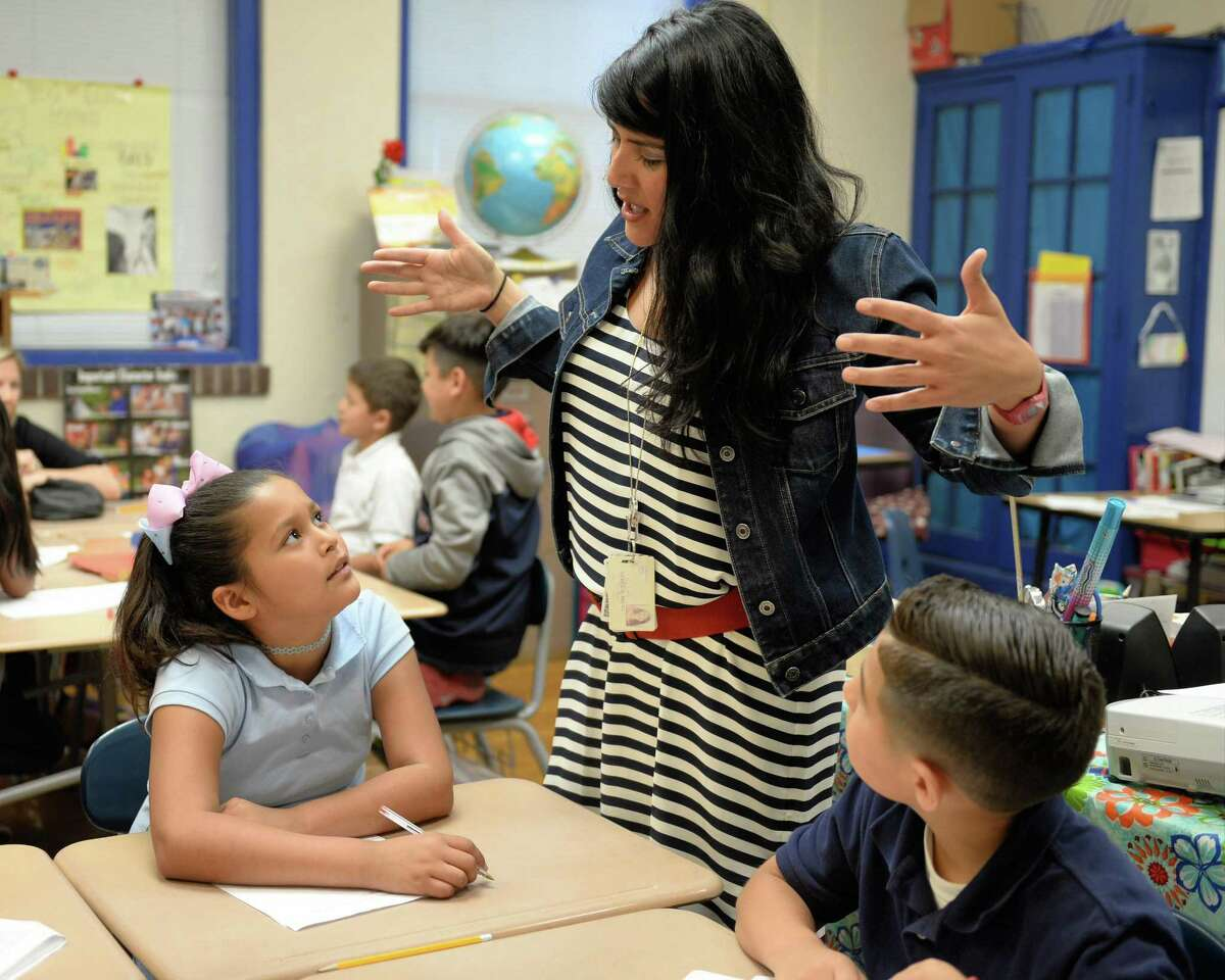 In this 2017 file photo, Field Elementary School third-grade reading and language arts teacher Mary Sayegh helps students working on a project. Houston ISD's Field Elementary received a 2019 National Blue Ribbon Award, one of the nation's highest honors in education.