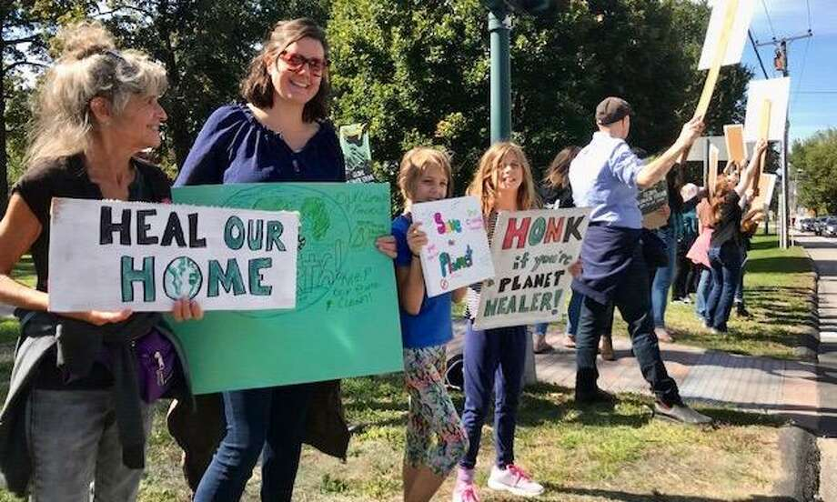 Residents joined the local group, Earth Rejoice for a a demonstration on the Litchfield Green Sept. 20 to raise awareness of climate change. Photo: Mindy Keskinen, Wallpaper22 / Contributed Photo /