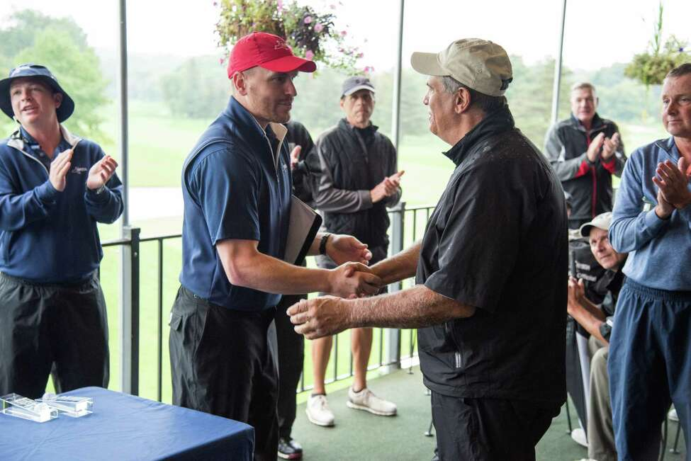 Dan Russo of Schuyler Meadows, right, accepts the Bill Stark Bowl from NYSGA assistant executive director Andrew Hockey on Thursday, Sept. 26, 2019, after winning the 2019 New York State Senior Amateur at the Cavalry Club in Manlius, N.Y. (Dan Thompson/NYSGA)