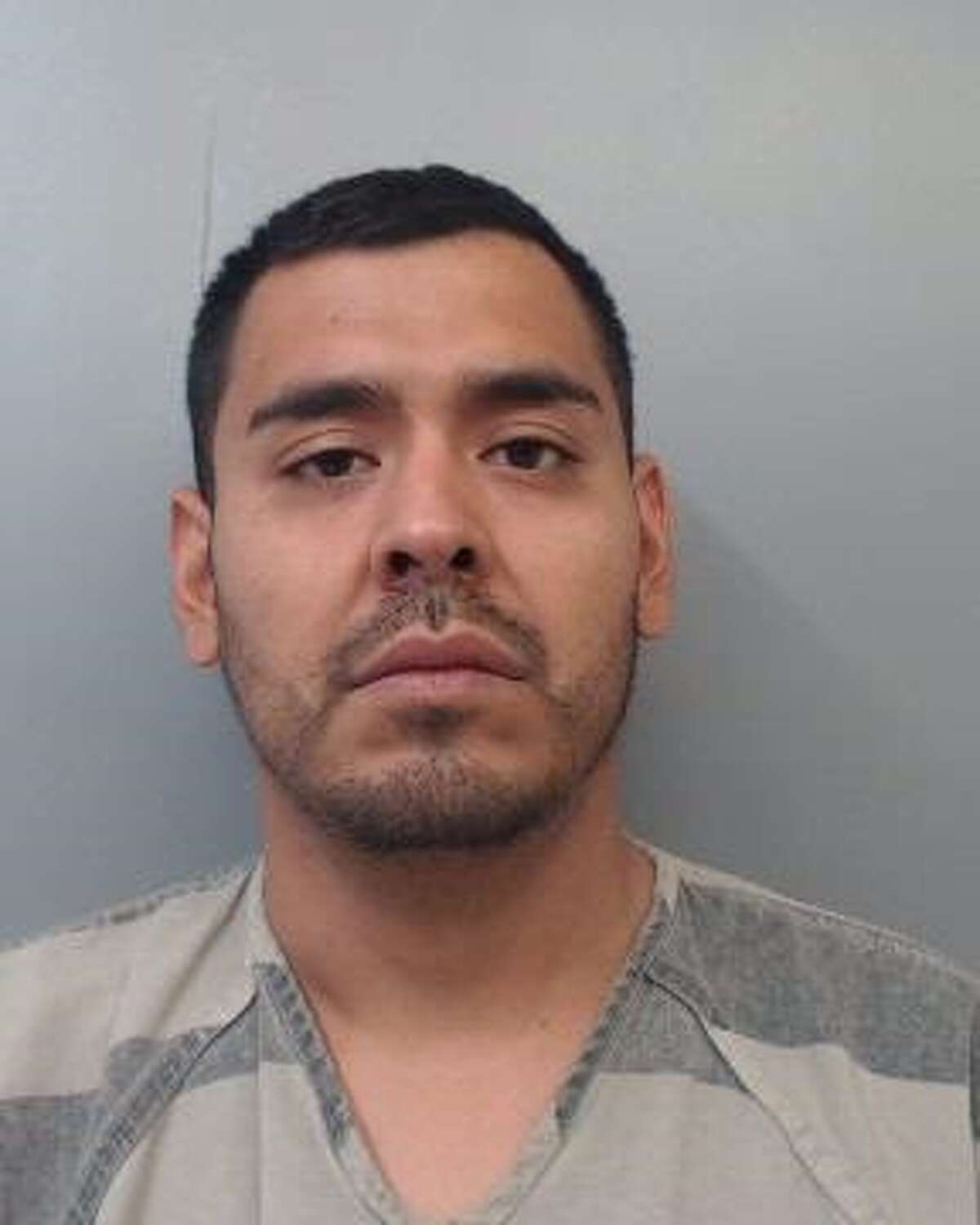 Martin Salvador Licea Rosales, 25, was charged with assault, family violence.