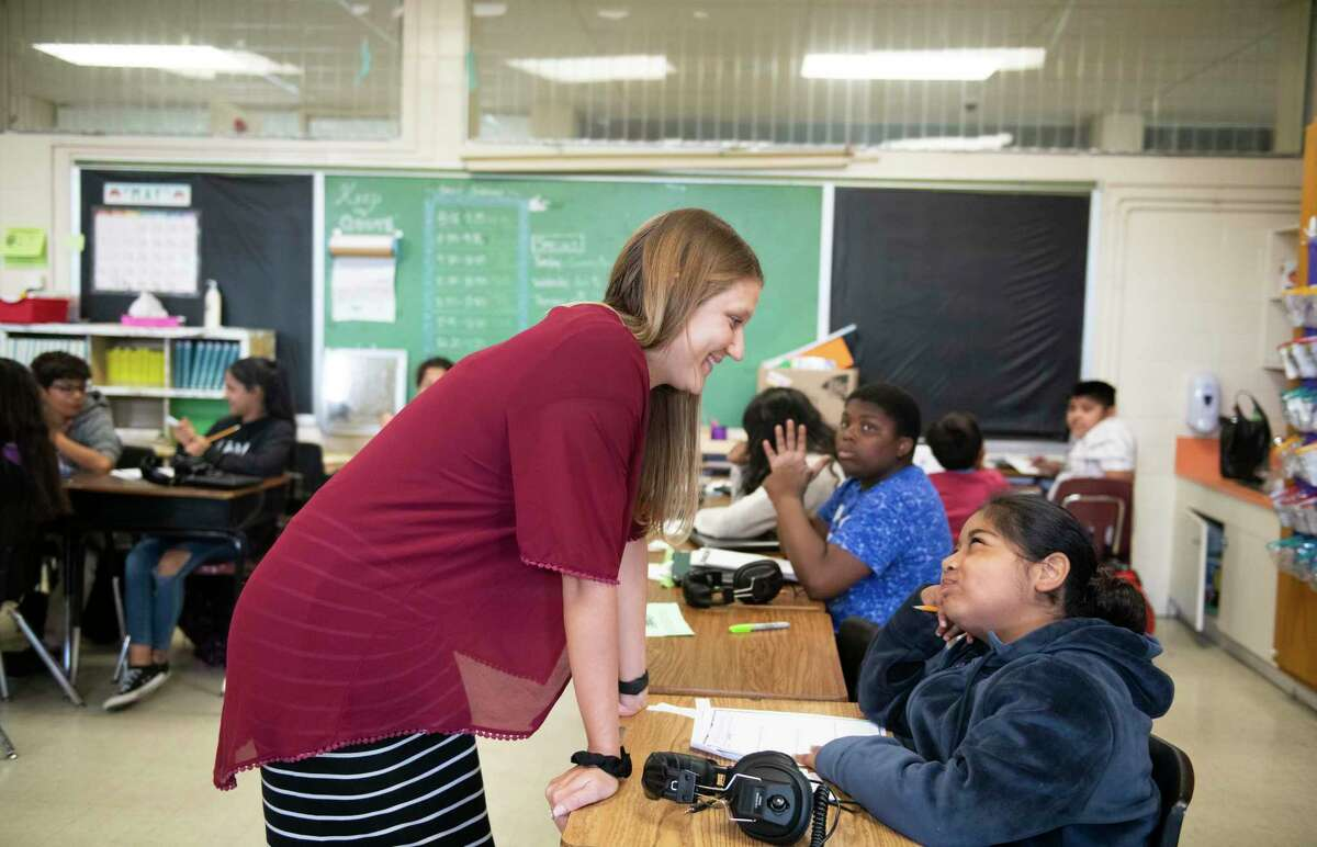 """Fifth grade teacher, Kayla John, speaks with Sua Salaiz, 11, during class at the elementary on Tuesday, May 28th, 2019. When Superintendent Pedro Martinez came to SAISD in 2015, Gates Elementary was a failing school. Now the high-poverty East Side campus has an """"A"""" from the state and is a poster child for Martinez's ambitious districtwide turnaround efforts. Houston-based nonprofit Children at Risk named Gates a """"gold ribbon"""" school, for high performance despite high poverty, in rankings that will be released June 2. Somerset Elementary also received a gold ribbon, although San Antonio schools overall trail behind other regions of the state in Children at Risk's rankings. Until last year, Children at Risk produced the only statewide rankings that took student poverty into account. Now it's are a factor in the state accountability system, but the nonprofit is partnering with the state to release their rankings quicker after new state grades come out in August, and lobbying the TEA against loosening standards in the face of opposition from educators and legislators."""