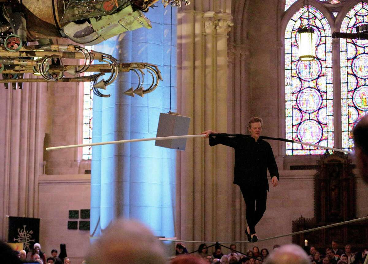 NEW YORK, NY - MARCH 01: A tightrope performance by Artist Philippe Petit during