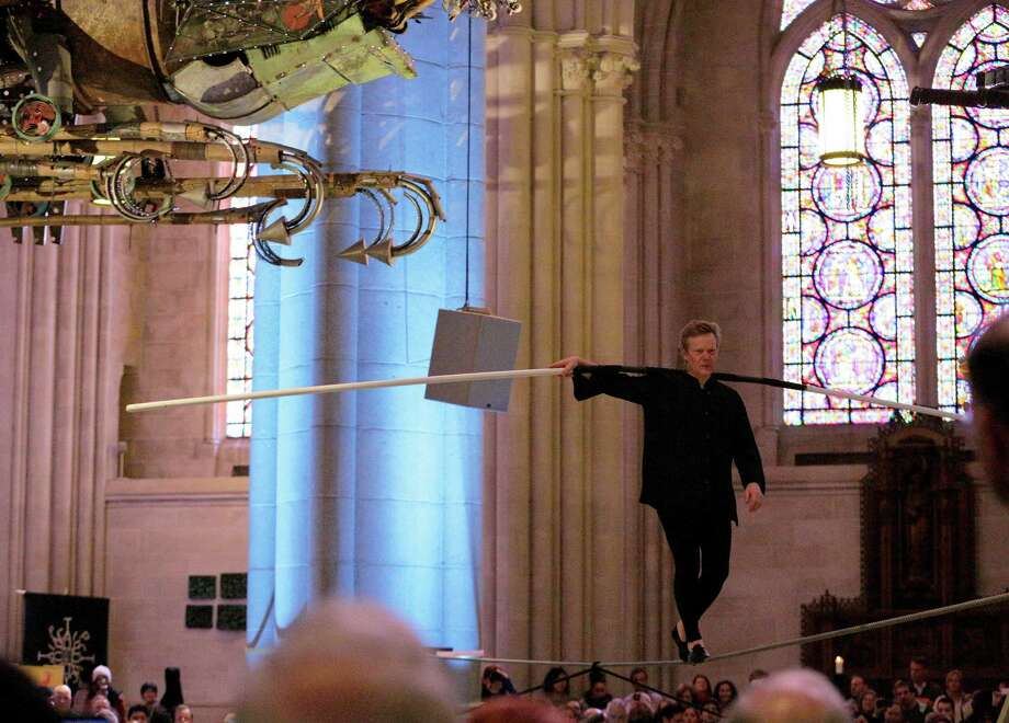 """NEW YORK, NY - MARCH 01:   A tightrope performance by Artist Philippe Petit during """"Phoenix: Xu Bing At The Cathedral"""" Press Preview at The Cathedral Church of St. John the Divine on March 1, 2014 in New York City.  (Photo by Andrew Toth/Getty Images) Photo: Andrew Toth / 2014 Andrew Toth"""