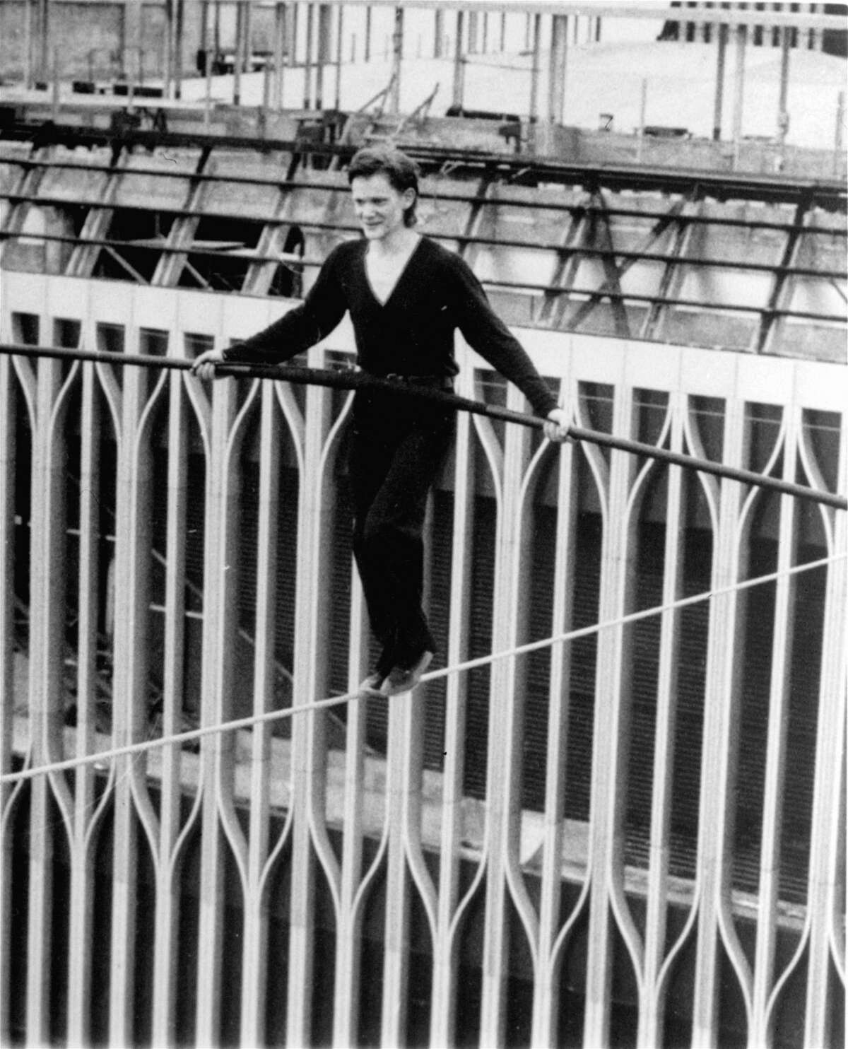 FILE--French aerialist Philippe Petit, 24, balances as he crosses a cable stretched between the World Trade Center towers high above New York City Wednesday, Aug. 7, 1974. Petit walked from one rooftop to a point close to the second rooftop and back again as crowds gathered on the lower Manhattan streets to watch the aerial feat. 'It remains one of the most important, most beautiful walks I have ever done,' Petit said in a recent interview with The Associated Press from his upstate home near Woodstock. (AP Photo/Alan Welner)
