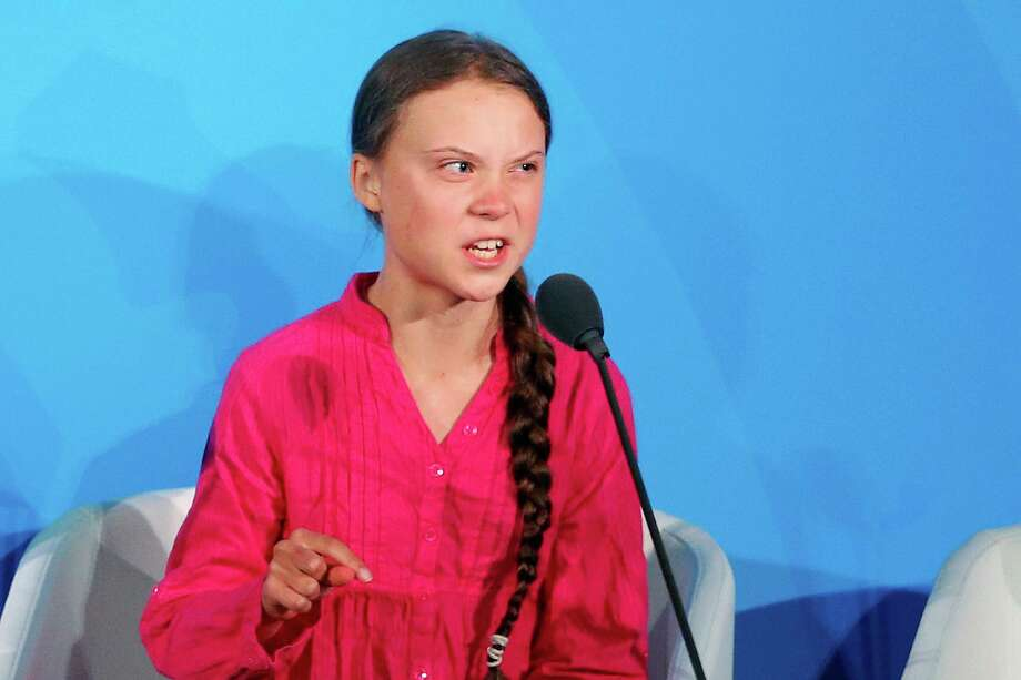"Environmental activist Greta Thunberg, of Sweden, addresses the Climate Action Summit at the United Nations General Assembly at U.N. headquarters Sept. 23. She gives mostly emotionless talks, but on Monday, she shed the stick-to-the-science message and frequently choked up when she scolded world leaders at the United Nations, repeating the phrase ""how dare you"" over and over in a highly praised address. Photo: Jason DeCrow / Associated Press / FR103966 AP"