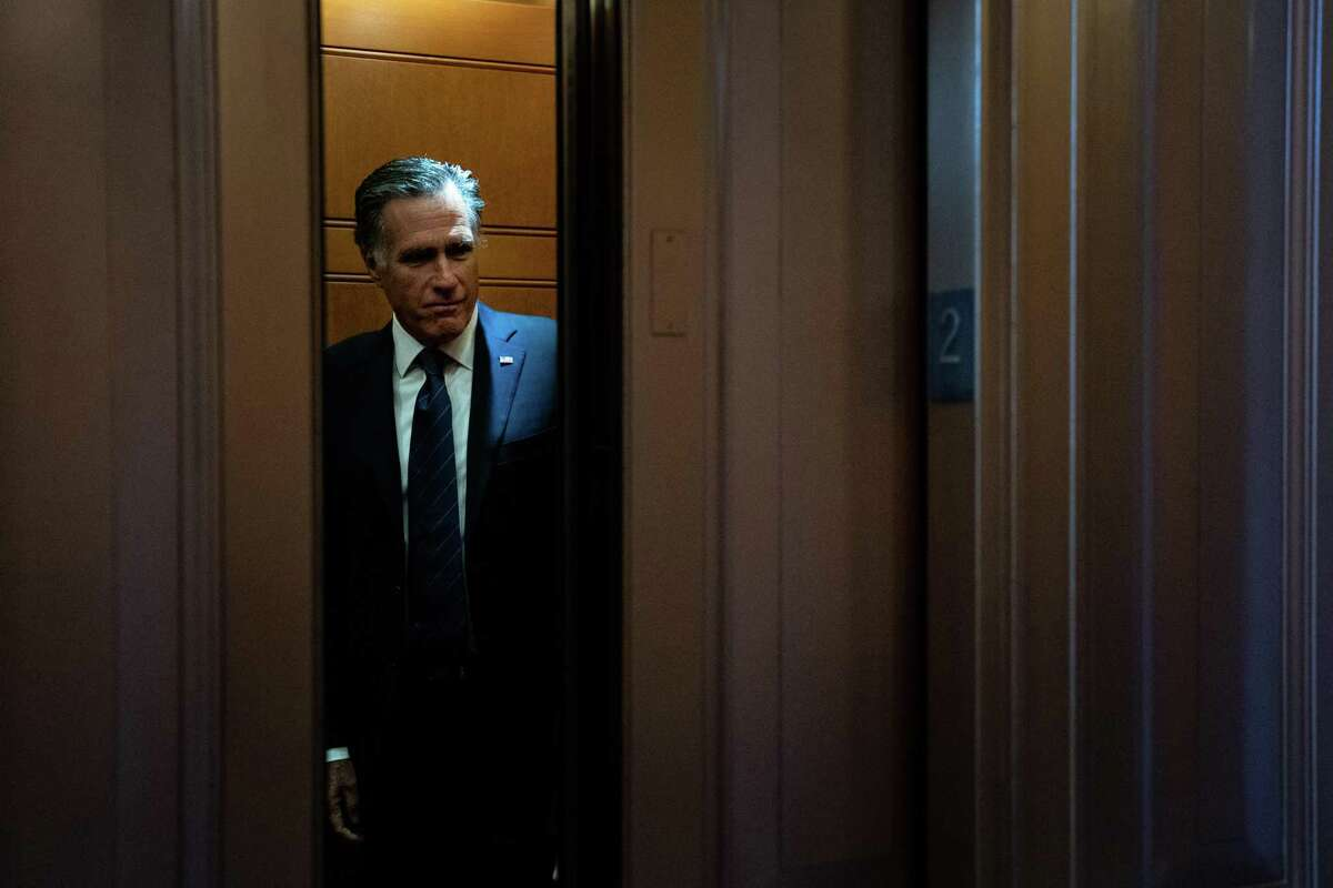 Sen. Mitt Romney (R-Utah) boards an elevator at the Capitol in Washington. Romney says the politics in the Senate's Republican caucus makes it difficult to advance climate change legislation.