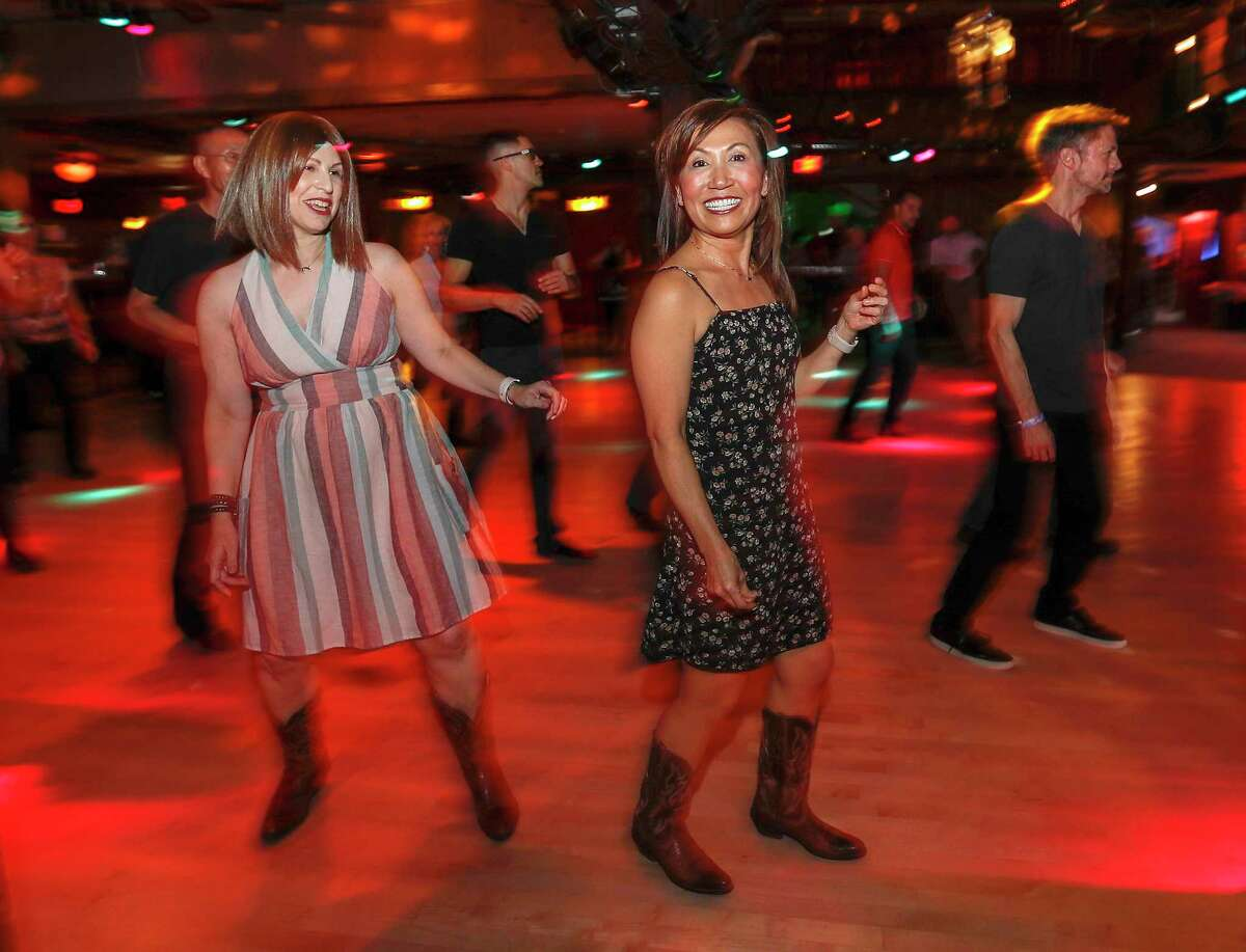 Allison Rosen dances with her friend Alison Duran at the club Wild West, Friday, August 9, 2019. Allison Rosen is a colorectal cancer survivor. She was diagnosed at 31 and has endured multiple surgeries, radiation therapy and chemo in the last seven years. She has a permanent ileostomy after almost dying from septicemia. But nothing is holding her back. She's an active volunteer at MD Anderson and still studies science for the Baylor College of Medicine.