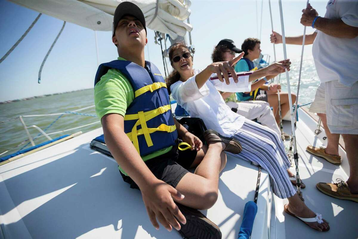 Rishi Trivedi, 17, and his mother, Sheela Trivedi, sail in a Sailing Angels boat in Clear Lake, Thursday, July 25, 2019. Sailing Angels provides a sailing experience for children and adult with disabilities, takes out families