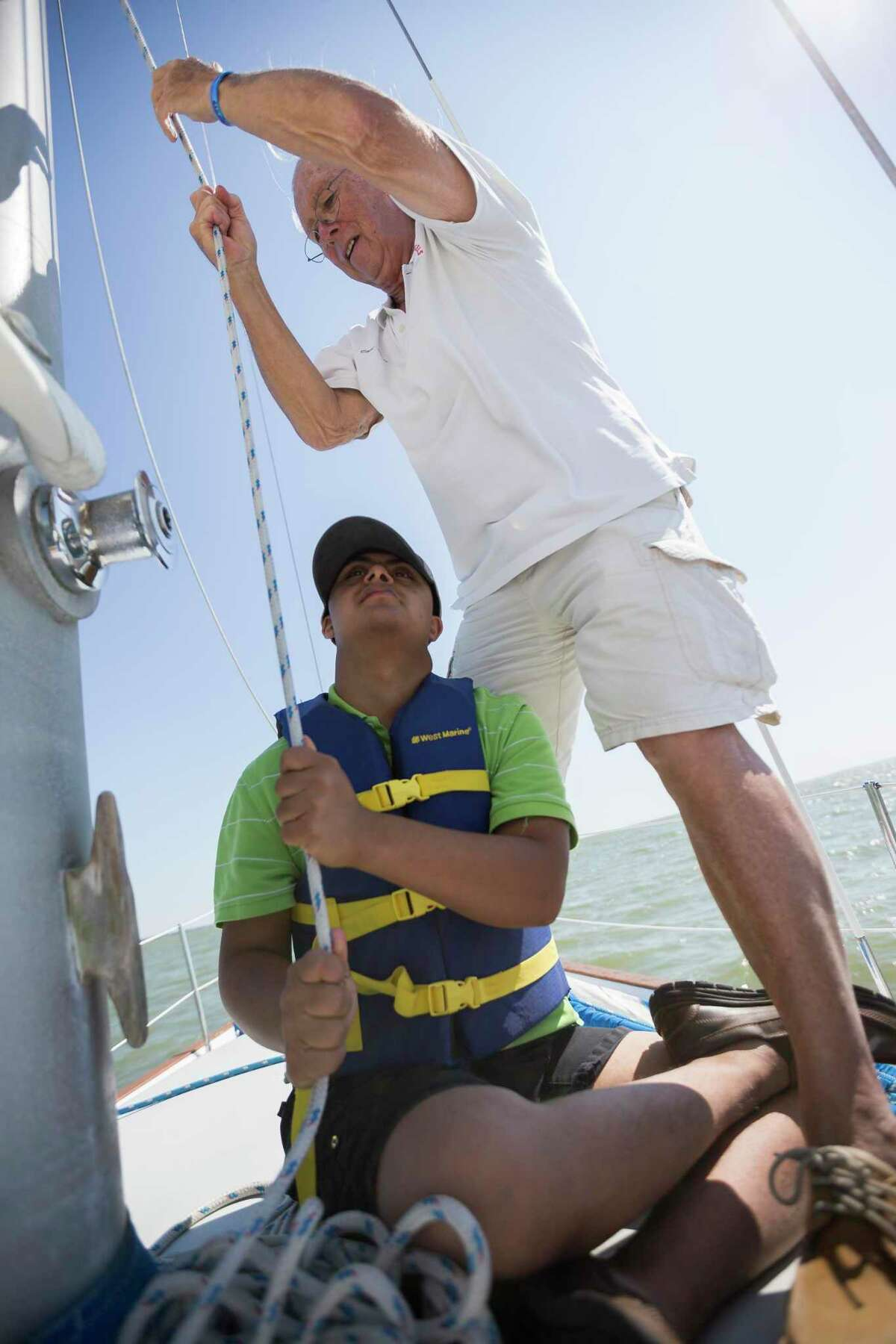 Rishi helps McCabe hoist a sail. All aboard work to the best of their ability in their time on the water.