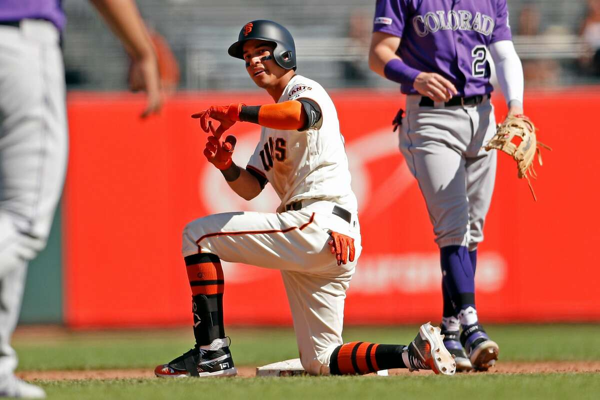 San Francisco Giants' Mauricio Dubon signals to the dugout after advancing to second base on Colorado Rockies' Sam Hilliard's error on his single that scored a run in 5th inning during MLB game at Oracle Park in San Francisco, Calif., on Thursday, September 26, 2019.