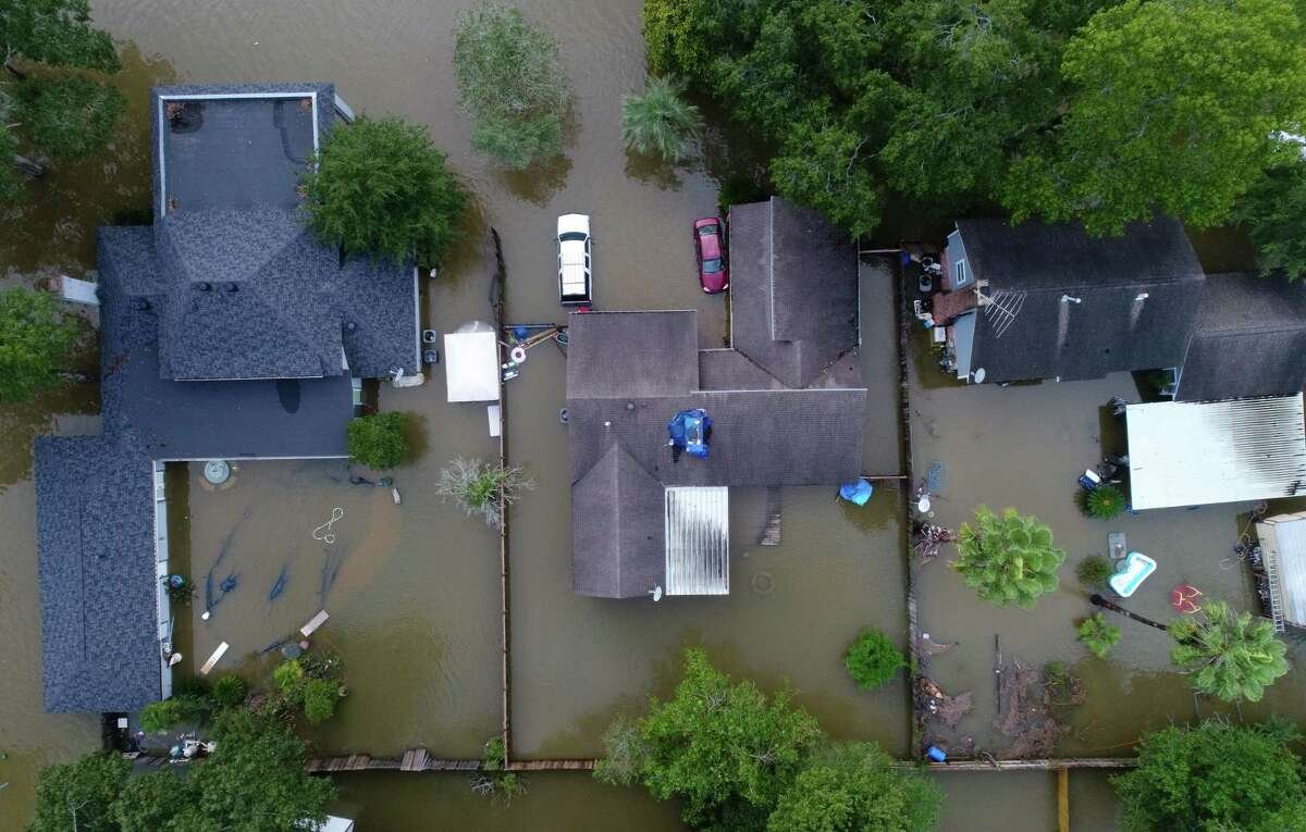 Flooded homes in the Lochshire neighborhood Friday, Sept. 20, 2019, in Huffman, Texas. Tropical Storm Imelda dumped 43 inches of rain in the greater Houston area.
