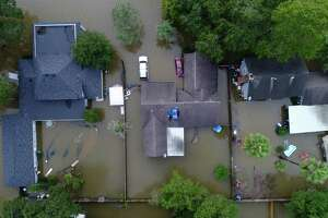 Flooded homes in the Lochshire neighborhood Friday, Sept. 20, 2019, in Huffman, Texas. The remnants of Tropical Storm Imelda dumped 43 inches of rain in the greater Houston area.