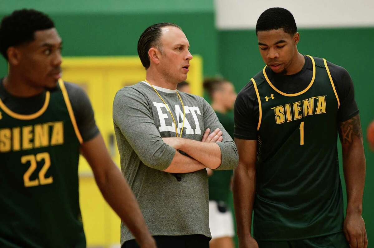 Head Coach Carmen Maciariello, center, talks to Elijah Burns, #1, as the Siena men's basketball team hold its first official practice of the season at Siena College on Thursday, Sept. 26, 2019 in Loudonville, N.Y. (Lori Van Buren/Times Union)