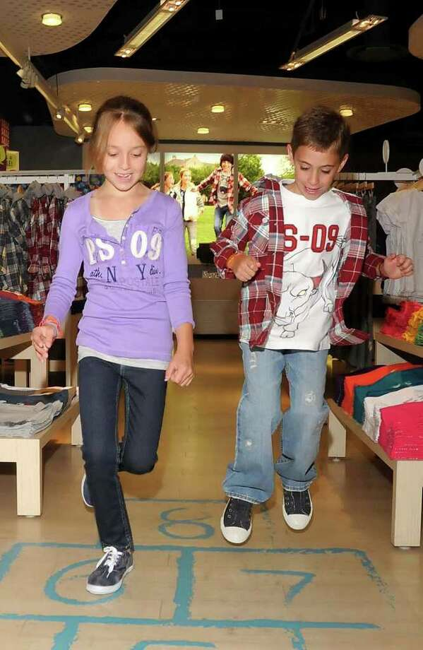 Lauren Carter, 7, of New Fairfield, left, and Dylan Jowdy, 6, of Danbury, model back to school fashions at P.S.Jeans from Aeropostale in the Danbury Fair Mall on Wed. August 4, 2010. Photo: Lisa Weir / The News-Times Freelance