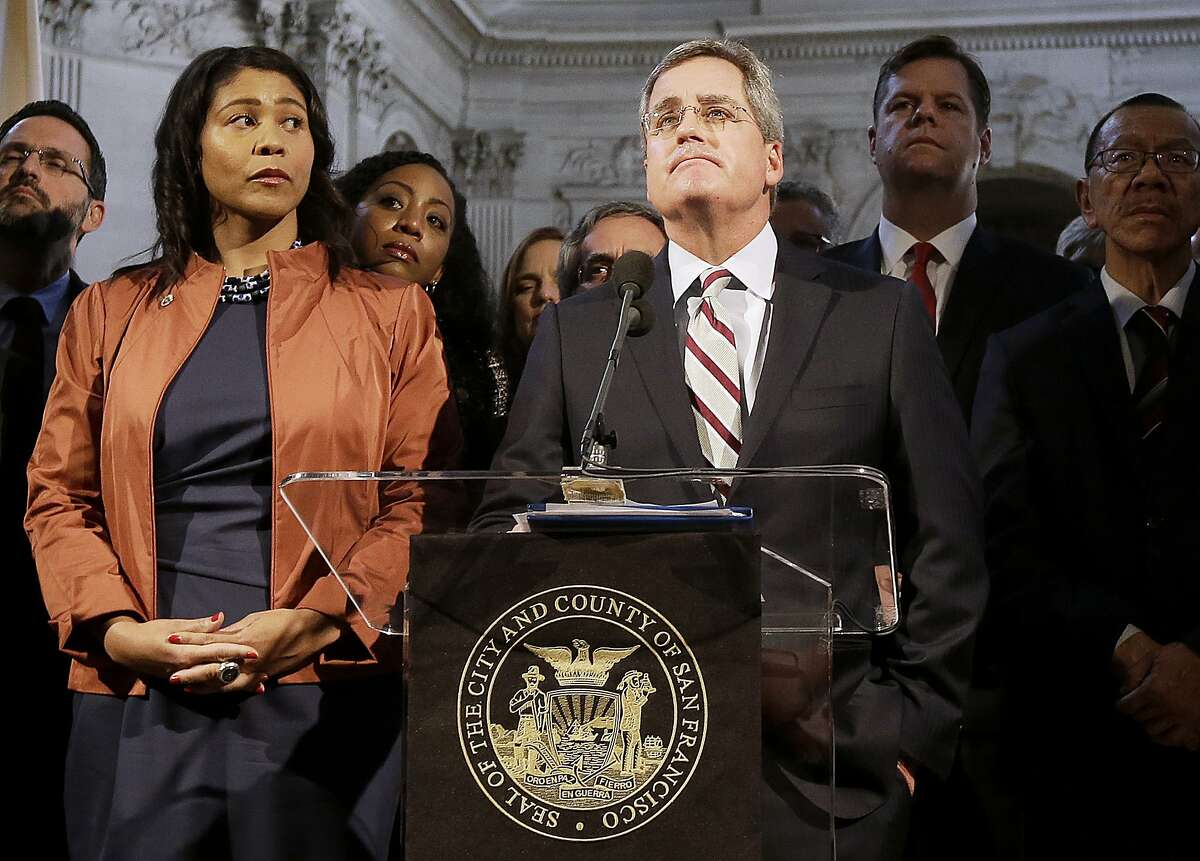 FILE - In this Dec. 12, 2017 file photo, city attorney Dennis Herrera, center, speaks at a news conference next to acting mayor London Breed, left, at City Hall in San Francisco.