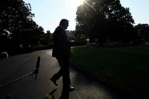 FILE - In this Sunday, Sept. 22, 2019, file photo President Donald Trump walks away after talking with reporters on the South Lawn of the White House in Washington as he prepares to board Marine One for the short trip to Andrews Air Force Base. The Democratic impeachment inquiry may give Trump extra motivation to end his trade war with China, claim credit for a policy victory and divert a little attention from a congressional investigation into his dealings with Ukraine. (AP Photo/Susan Walsh, File)