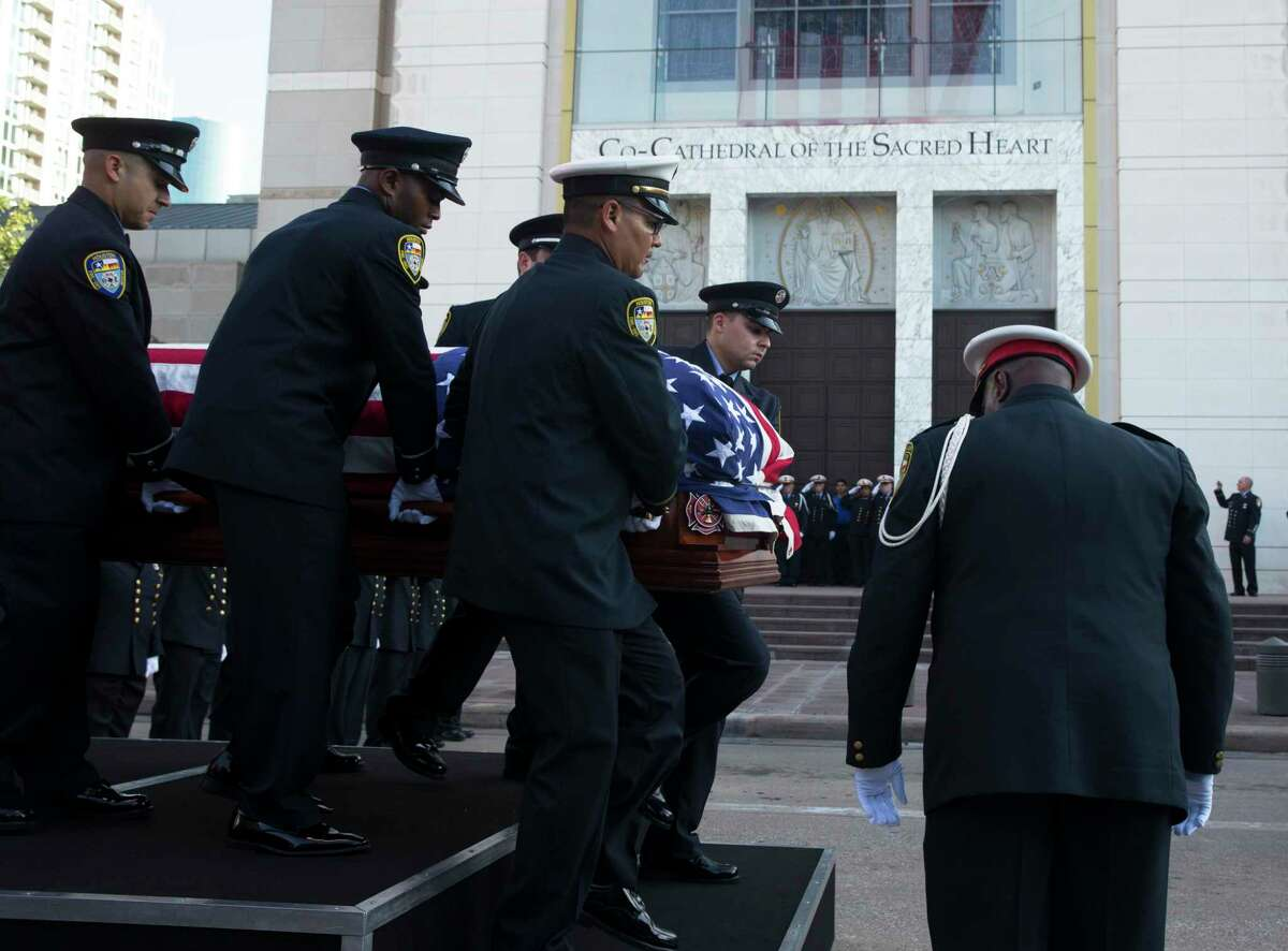 Houston Fire Department Honor Guards carry casket of firefighter Kenneth Stavinoha off of Station 27 fire truck as they arrive at the Co-Cathedral of the Sacred Heart for his funeral on Thursday, Sept. 26, 2019, in Houston.