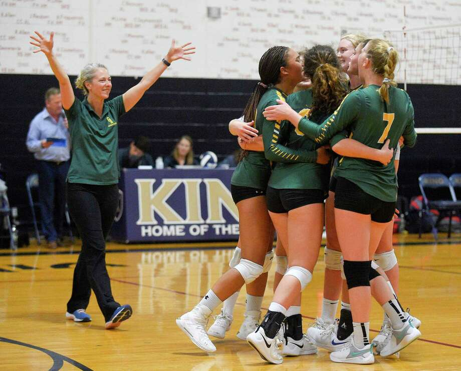 Greenwich Academy coach Christy Girard and her players celebrate after topping King 3-0 (25-19, 25-12, 25-20) in a FAA girls volleyball match at King School on Sept. 26, 2019 in Stamford, Connecticut. Photo: Matthew Brown / Hearst Connecticut Media / Stamford Advocate