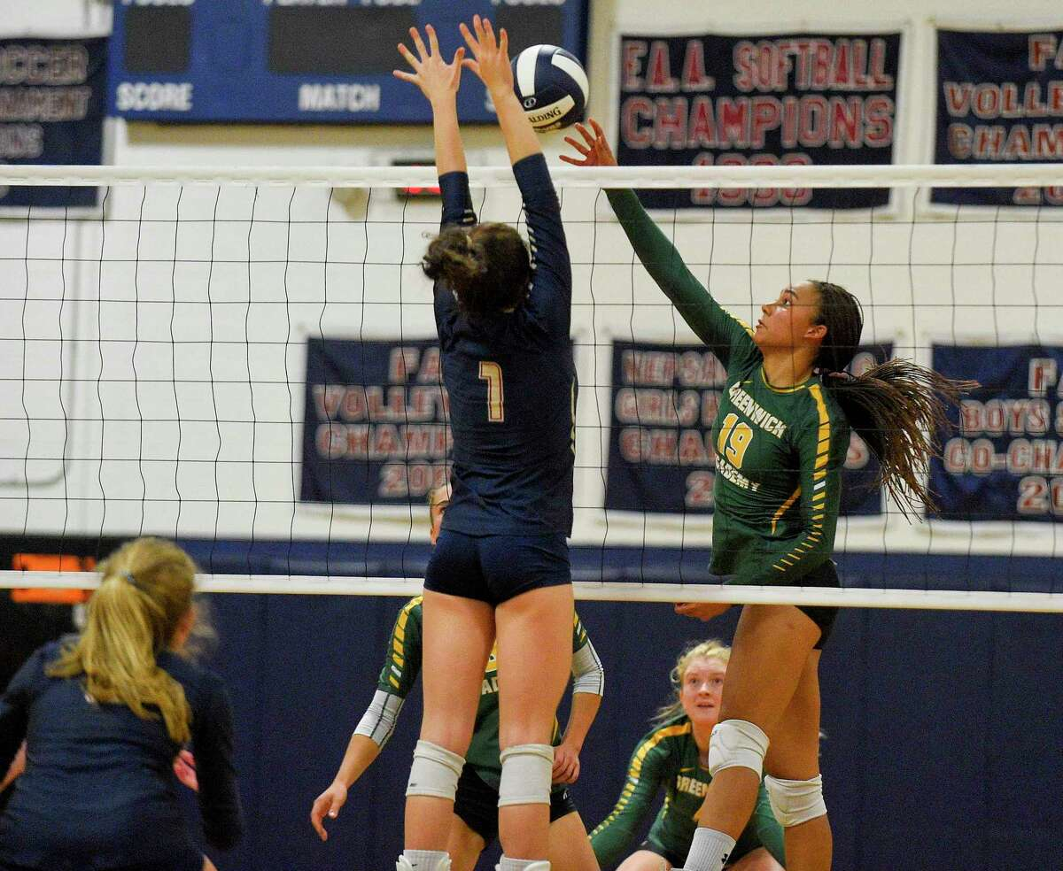 Greenwich Academy's Alexandra Trofort (19) taps the ball past King's Norah Shattan (1) as the Gator's topped the Vikings 3-0 (25-19, 25-12, 25-20) in a FAA girls volleyball match at King School on Sept. 26, 2019 in Stamford, Connecticut.