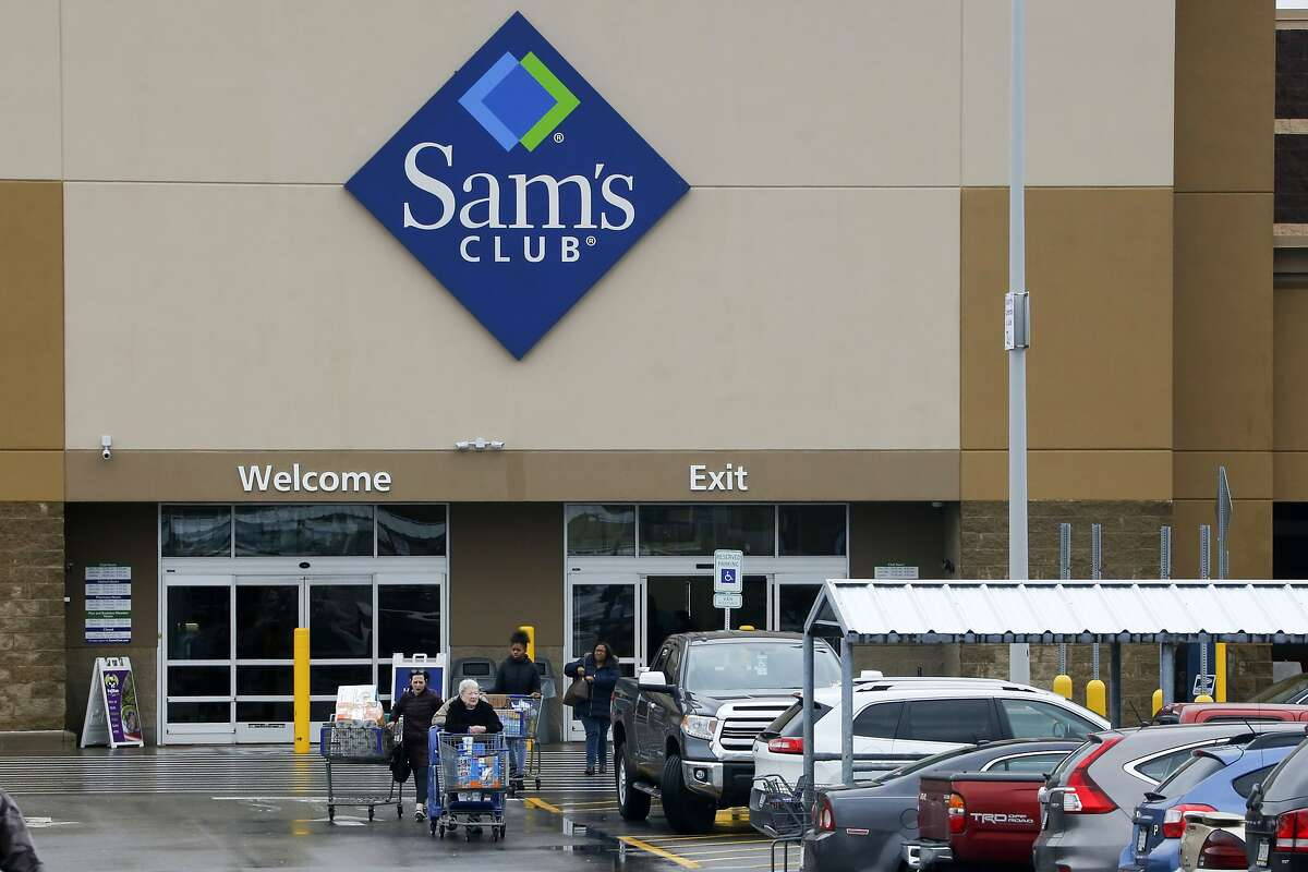 File- This Feb. 23, 2018, file photo shows shoppers leaving a Sam's Club in Pittsburgh. Walmart's Sam's Club is teaming up with several health care companies to offer discounts on everyday care its customers might delay or skip because of the cost. Starting early October, Sam's Club members in Michigan, Pennsylvania and North Carolina, will be able to buy one of four bundles of health care services ranging in annual fees from $50 for individuals to $240 for a family of up to six members. The pilot program could potentially be rolled out to members in all the states, says Lori Flees, senior vice president of Sam's Club Health and Wellness. (AP Photo/Gene J. Puskar, File)