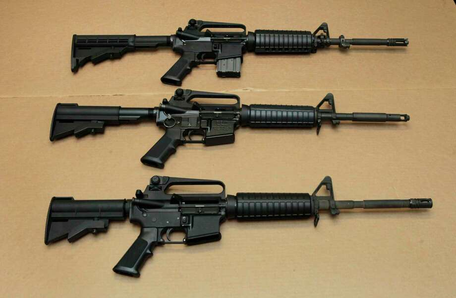 FILE -- In this Aug. 15, 2012 file photo, three variations of the AR-15 assault rifle are displayed at the California Department of Justice in Sacramento, Calif. (AP Photo/Rich Pedroncelli,file) Photo: Rich Pedroncelli,  STF / Associated Press / Copyright 2016 The Associated Press. All rights reserved. This material may not be published, broadcast, rewritten or redistribu