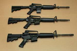 FILE -- In this Aug. 15, 2012 file photo, three variations of the AR-15 assault rifle are displayed at the California Department of Justice in Sacramento, Calif. (AP Photo/Rich Pedroncelli,file)