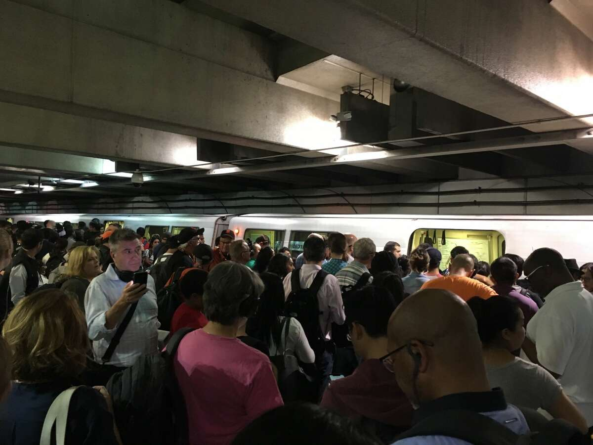 Dozens of BART passengers crowded the platform of the Embarcadero station as passengers were asked to disembark the train.