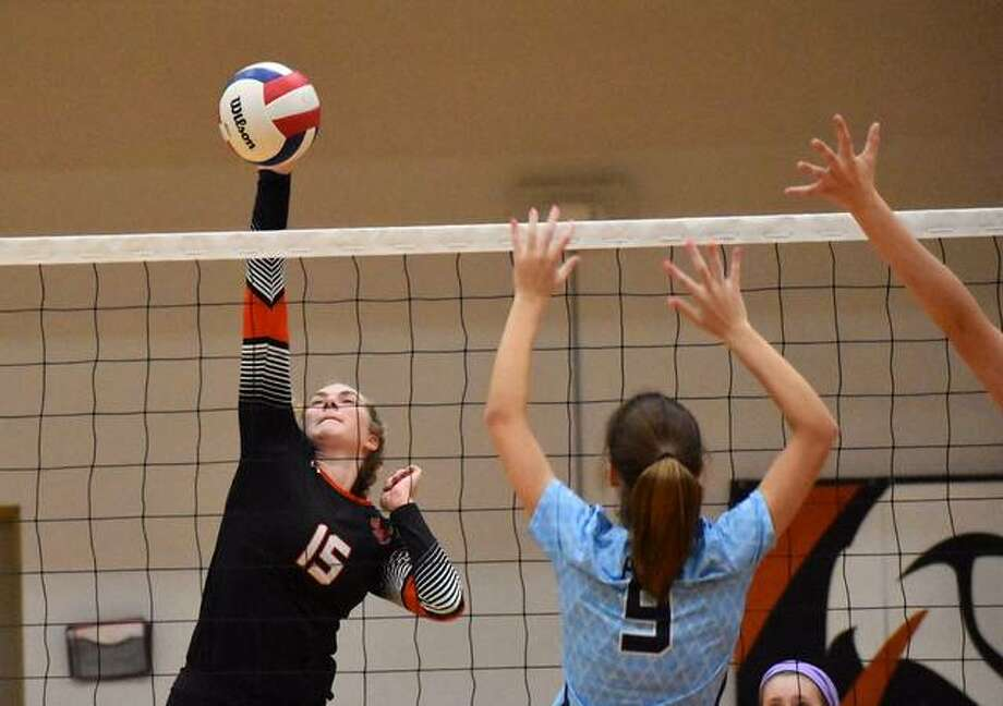Edwardsville's Lexi Curtis slams down a kill in the first game against Belleville East. Photo: Matt Kamp|The Intelligencer