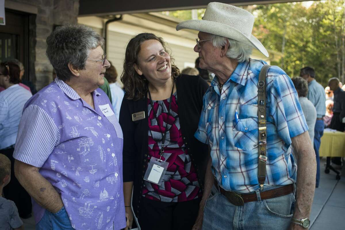 Eleanor Payne, left, Jessica Hufford, center, and Nolan Stilgenbauer, right, chat during an open house event for the new Sanford Activity and Dining Center Wednesday, Sept. 25, 2019 in Sanford. (Katy Kildee/kkildee@mdn.net)