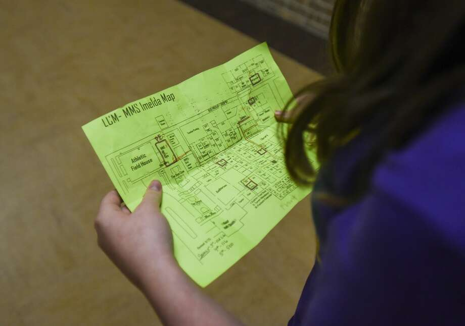 A student uses a highlighted map of different rooms that middle school students are using as classrooms at Little Cypress-Mauriceville High School Thursday afternoon. Photo taken on Thursday, 09/26/19. Ryan Welch/The Enterprise Photo: Ryan Welch/The Enterprise