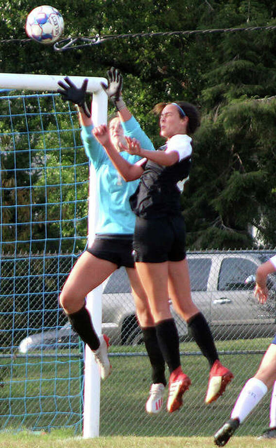 St. Louis Community College goalie Kelly Cates reaches for the ball after a header by LCCC's Carly Smith in the second half of Thursday's game at Meramec Community College. Photo: Pete Hayes | The Telegraph