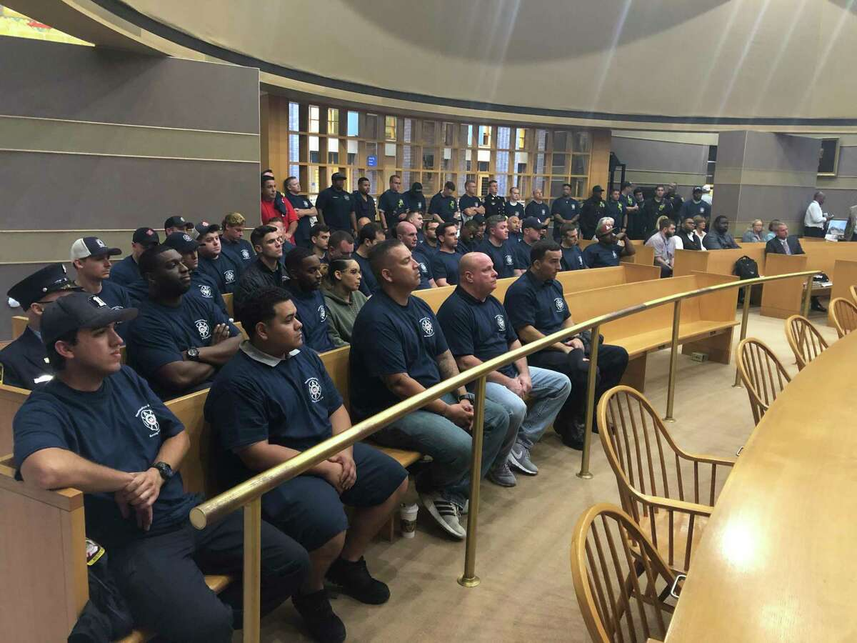The Board of Alders Finance Committee considered and passed the potential contract for city firefighters onto the full body Thursday evening. Here, firefighters in attendance.